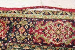 Obszywanie maszynowe starego dywanu